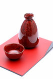 Japanese sake bottle and cups. On tray, isolated on white background Royalty Free Stock Photo