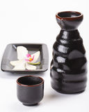 Japanese sake cup and bottle and orchid flower Stock Image
