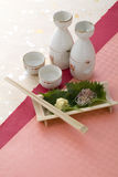 Japanese sake and garnish Stock Images