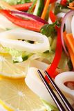 Japanese salad with vegetables and squid macro. Vertical Stock Photography