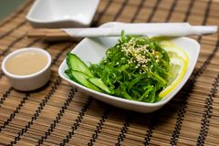 Japanese salad with wakame algae. In the white bowl Royalty Free Stock Photography