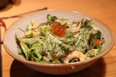Japanese salad with walleye pollack roe royalty free stock photos