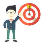 Japanese salesman hit the sales target. A japanese salesman happy standing while his hand pointing to the arrow from target pad shows that he hit his target Royalty Free Stock Photography