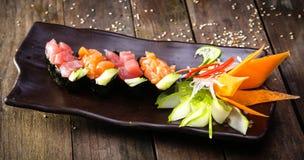 Japanese Salmon sushi and sauce closeup Royalty Free Stock Photos