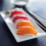 Japanese salmon and tuna nigiri on white plate Stock Image