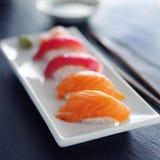 Japanese salmon and tuna nigiri on white plate Stock Image