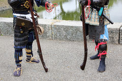 Japanese samurai clothing uniform with old rifle. KAGAWA, JAPAN - NOVEMBER 20: Ancient firelock rifle fighters at Marugame Historical battle Festival, event Stock Photography