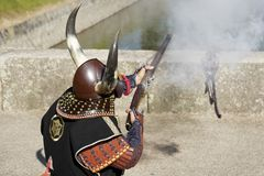 Japanese samurai with fire lock rifle stock images
