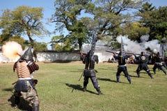 Japanese samurai with fire lock rifle Royalty Free Stock Photos
