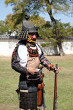 Japanese samurai with fire lock rifle. KAGAWA, JAPAN - OCTOBER 25: Ancient firelock rifle fighters at Marugame Historical battle Festival, event dedicated to Stock Images