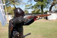 Japanese samurai with fire lock rifle Royalty Free Stock Image