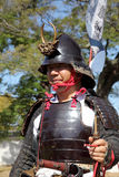 Japanese samurai with fire lock rifle. KAGAWA, JAPAN - OCTOBER 25: Ancient firelock rifle fighters at Marugame Historical battle Festival, event dedicated to Royalty Free Stock Photos