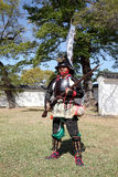 Japanese samurai with fire lock rifle. KAGAWA, JAPAN - OCTOBER 25: Ancient firelock rifle fighters at Marugame Historical battle Festival, event dedicated to Stock Image
