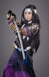 Japanese samurai with katana sword. Studio shoot. Isolated stock photography