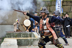 Japanese samurai with old rifle. KAGAWA, JAPAN - NOVEMBER 20: Ancient firelock rifle fighters at Marugame Historical battle Festival, event dedicated to Japanese Royalty Free Stock Images