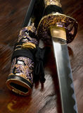 Japanese Samurai Sword. Samurai sword from Japan on wooden table Stock Images