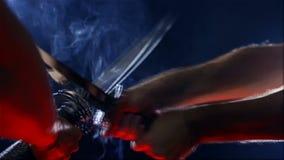 Japanese samurai warriors fighting with swords. Blade close-up. Japanese samurai warriors fighting with swords. Sword battle. Two Japanese katana sword. Blade stock footage