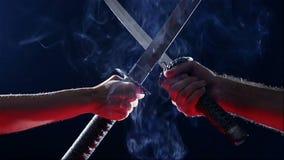 Japanese samurai warriors fighting with swords. Blade close-up. Japanese samurai warriors fighting with swords. Sword battle. Two Japanese katana sword. Blade stock video