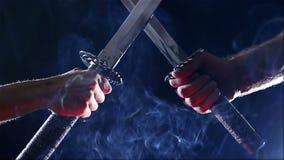 Japanese samurai warriors fighting with swords. Blade close-up. Japanese samurai warriors fighting with swords. Sword battle. Two Japanese katana sword. Blade stock video footage