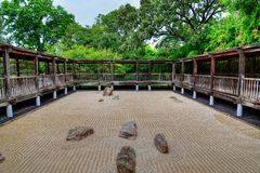 Japanese sand and rock garden. With weathered walkway. Located in Fort Worth Texas royalty free stock photo