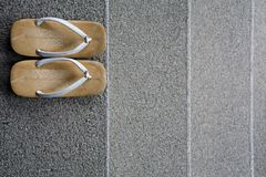 Japanese sandals. Japanese monks sandals arranged at the top of some steps stock photography