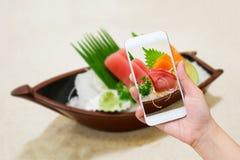 Japanese sashimi sushi set on sushi boat plate Royalty Free Stock Photos