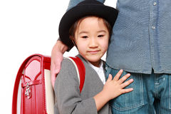 Japanese school girl with satchel with her father Royalty Free Stock Photo
