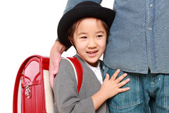 Japanese school girl with satchel walking to school with her father Stock Images