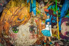 Japanese school girl sculpture in front of painting by Takashi Murakami. From the `Murakami by Murakami` exhibition at Astrup Fearnley Museet in Oslo, Norway Stock Photos