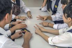 Japanese Schoolchildren Playing Rock–Paper–Scissors At Kyoto Japan 2015.  stock photos