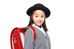 Japanese Schoolgirl With Red Satchel Smiles Royalty Free Stock Image