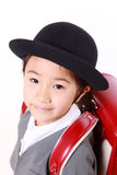 Japanese Schoolgirl. Studio shot of Japanese Schoolgirl With Red Satchel Smiles Stock Photo