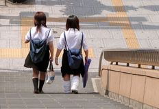 Japanese schoolgirls. In a sunny hot summer day Royalty Free Stock Image