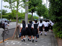 Japanese schoolgirls. A traditional group of Japanese schoolgirls in their every day morning way to the school Stock Images