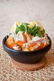 Japanese Seafood Hot Pot. A bowl of seafood hot pot in japanese style, including vegetable, shrimp, clam, mushroom Stock Photography