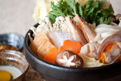 Japanese Seafood Hot Pot. A bowl of seafood hot pot in japanese style, including vegetable, shrimp, clam, mushroom Royalty Free Stock Photography