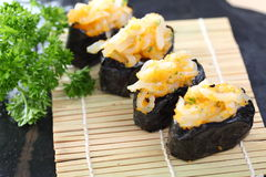 Japanese seafood sushi on bamboo mat Stock Photography