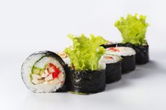 Japanese seafood sushi. Roll on a light background Stock Image