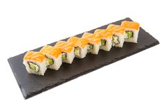 Japanese seafood sushi, roll on a white background. Sushi isolated on shale food board on white background royalty free stock images