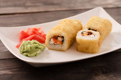 Japanese seafood sushi, roll on a white plate Royalty Free Stock Image