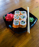 Japanese seafood sushi rolls with chopstick wasabi and ginger Royalty Free Stock Images