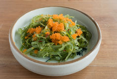Japanese seaweed salad with Fish Roe Flying Fish Eggs. Closeup of Japanese seaweed salad with Fish Roe Flying Fish Eggs Royalty Free Stock Images