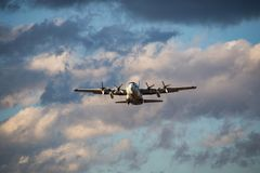 Japanese Self Defense Force C-130 Transport. A Japanese Self Defense Force C-130 Transport takes off from Naval Air Station Atsugi, an air base shared by the Royalty Free Stock Images
