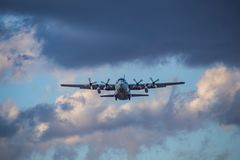 Japanese Self Defense Force C-130 Transport. A Japanese Self Defense Force C-130 Transport takes off from Naval Air Station Atsugi, an air base shared by the Stock Image