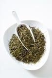 Japanese sencha tea, bowl, white background Stock Photos