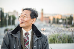 Japanese senior old man outdoors smiling and happy portrait.  Stock Photo