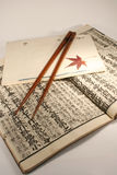 Japanese set. Old Japanese book from meiji period with chopsticks and japanese maple leaf Stock Photo