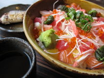 Japanese set meal. A Japanese set meal including sashimi with rice, a cup of tea and a roast fish Stock Image