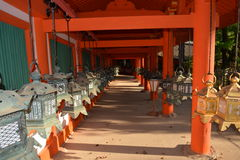 Japanese Shinto Shrine Lanterns. Japanese hanging lanterns in an open corridor of the Kasuga-taisha Shinto shrine in Nara, Japan Royalty Free Stock Image
