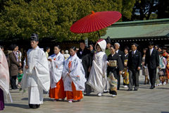 Japanese shinto wedding ceremony. Priests, maidens, new couple and their families wear traditional dress on the wedding   ceremony at Meiji Jingu Shrine Stock Photos